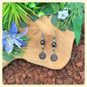 shop these lovely Hematite earrings with flower charm @ fensi jewelry boutique sieraden oorbellen edelsteen fancy fenneke smouter
